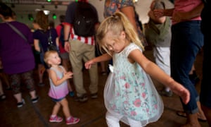 Children dance to the Minx, a Kinks tribute band, during Musikfest.