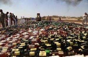 Karachi, Pakistan A steamroller destroys bottles of smuggled liquor