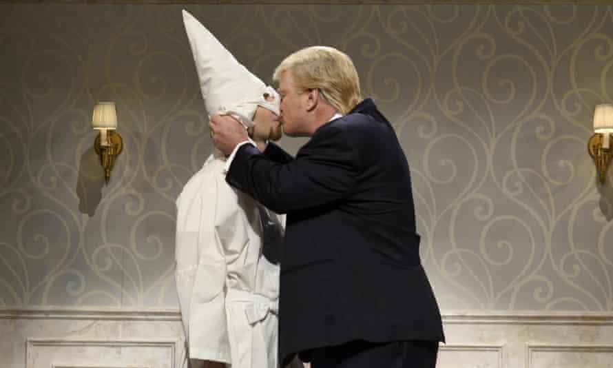 A Ku Klux Klan member and Alec Baldwin as Donald Trump kiss on Saturday Night Live.