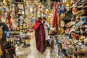 Hamid, an artisan who specialises in carnival costumes, suits up a customer at Ca' del Sol workshop in Venice. It uses traditional techniques to create ornate masks, such as the famous <em>bauta</em> (heavily gilded full face mask) and <em>colombina</em> (half-mask) and the historical masks of <em>commedia dell'arte </em>characters Arlecchino and Pantalone. Period costumes are made in damasks, brocades and oriental silks. But none of this comes cheap: outfits can be rented by the day from €150 but cost upwards of €2,000 to buy. The carnival runs until 28 February.