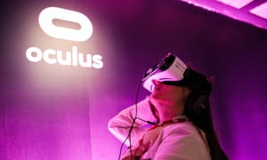A journalist tests out Oculus goggles during a press demonstration in San Francisco.