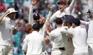 Moeen Ali celebrates with his England team-mates