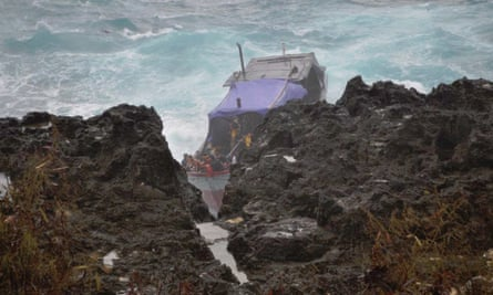 A photo from the 2012 coronial report, showing Siev 221 being forced against a cliff during the 2010 Christmas Island boat tragedy.