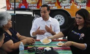 The Democratic presidential candidate Julián Castro speaks with Lupe Arreola, left, Astrid Silva, right, and others while visiting a taco truck, 28 February 2019, in North Las Vegas, Nevada.