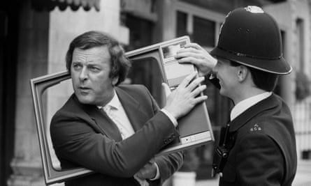 Terry Wogan jokes with a police officer