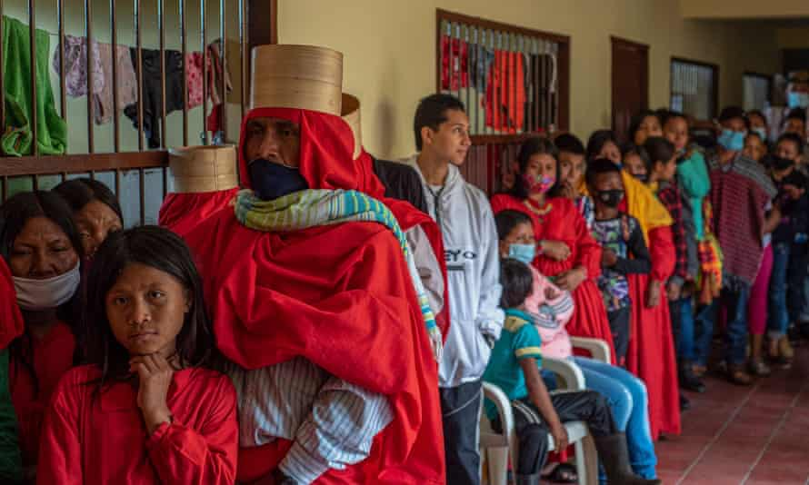 Indigenous Emberá people and displaced farmers line up for food at a local school used as a shelter in Ituango, Colombia, on 27 July.