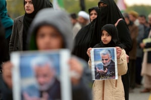Protesters carry posters of Soleimani during a demonstration in Islamabad in Pakistan