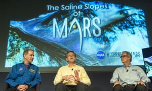 Nasa's John M Grunsfeld, Jim Green, and Michael Meyer discuss the discovery that liquid water flows on the surface of Mars during a press conference in Washington, DC, on 28 September 2015.
