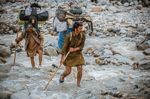 Balti porters carrying loads which range from 25kg to 50kg, a task they undertake often wearing only basic rubber sneakers filled with fresh grass to stop their feet slipping