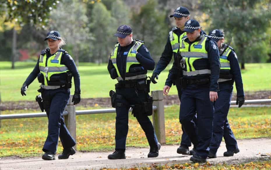 Police on patrol near a growing makeshift memorial for Eurydice Dixon at the Princes Park.