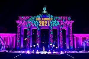 Berlin's Brandenburg gate is illuminated during a Willkommen 2021 concert