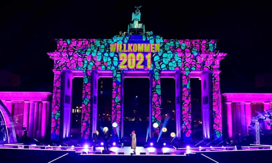 Berlin's Brandenburg Gate is illuminated during a Willkommen 2021 (Welcome 2021) concert.
