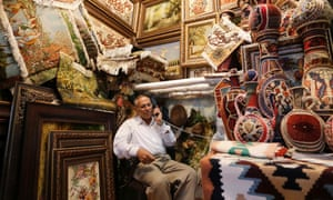 An Iranian shopkeeper waits for customers in Tehran's Grand Bazaar.