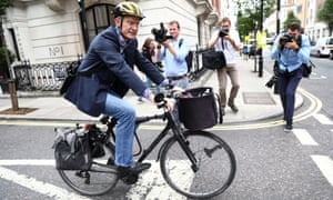 Jeremy Vine is dogged by journalists as he leaves Broadcasting House on Wednesday.