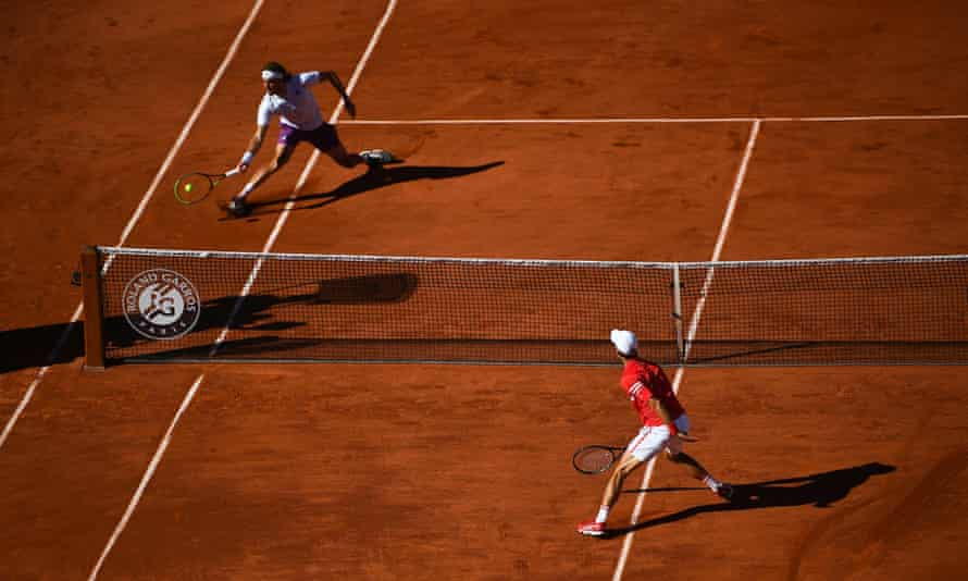 Djokovic and Tsitsipas contest a rally during their four-hour battle.