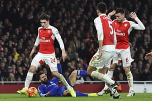 Chelsea's Cesc Fabregas falls in the area after a challenge from Arsenal's Laurent Koscielny.