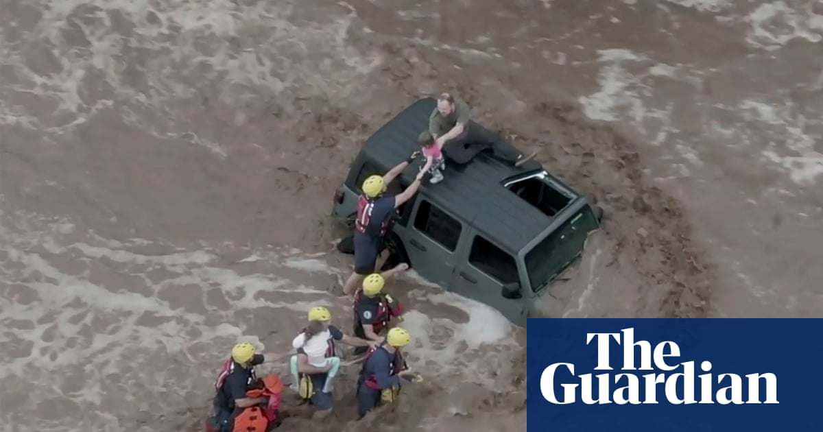 Arizona: stranded family rescued as flash floods inundate cities – video report