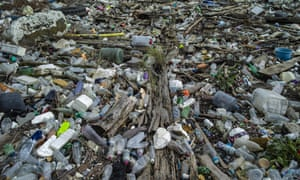 Plastic waste besides the Thames, Essex, UK. Environmentalists say only green sustainable societies could cope with climate change and pandemics.