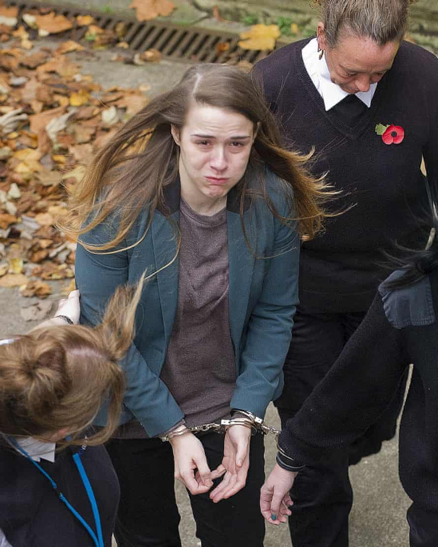 Gayle Newland is taken to prison after her first trial. That conviction was overturned.