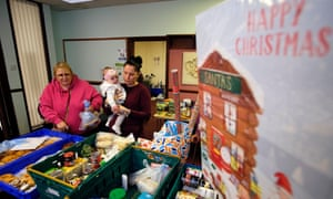 A family visits the Weston Favell food bank in Northampton.