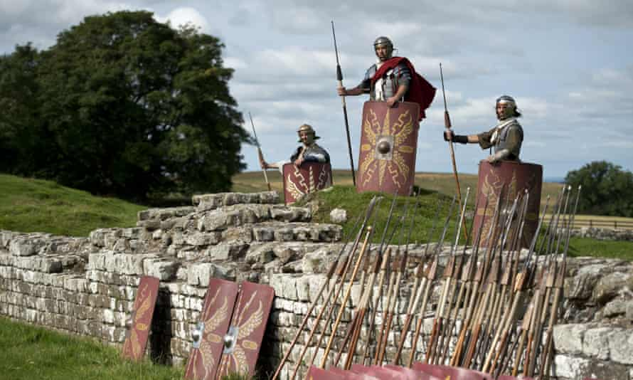 Re-enactors pose for a photograph at Birdoswald Roman fort near Gilsland, UK.