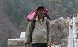 Paresh Nath posing with rucksack in the mountains