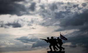 """A new British memorial to the second world war Normandy landings, by sculptor David Williams-Ellis, is silhouetted along """"Gold beach"""", at Arromanches-les-Bains."""