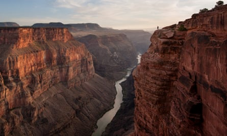 A man looking out over the Grand Canyon at Toroweap Point