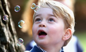 Prince George plays with bubbles.