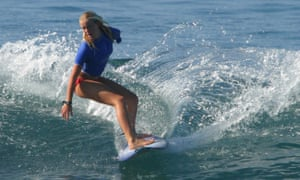 Bethany Hamilton rides a wave during the NSSA tournament in Hawaii in 2004, her first competition after losing her left arm.