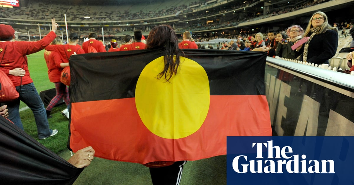 AFL slugged with retrospective bill for use of Aboriginal flag as fans urged to bring their own – The Guardian