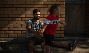Whalan, Sydney, New South Wales, Australia. A portrait of Isaih Sines and his nineteen month old son Teoke Kahuroa-Sines. SInes himself spent time in care and in juvenile detention and is now a Youth Ambassador for Just Reinvest NSW.  The Koori court program, which operates out of the Children's Court, was established at Parramatta in 2015 to reduce the number of Aboriginal and Torres Strait Islander children in custody and to provide interventions to help set these young people back on the right path. October 21, 2020. David Maurice Smith/Oculi.