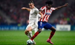 Gareth Bale and Thomas Partey battle for the ball in the Madrid derby.