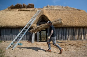 Chalton, EnglandMaster Thatcher Lyle Morgans works on the roof of a new Saxon hall at Butser Ancient farm in Hampshire. Based on a 7th century Anglo Saxon hall house found near Petersfield, it is being constructed using traditional timber framing and thatching techniques, using 3.5 tons of reed thatch on the roof