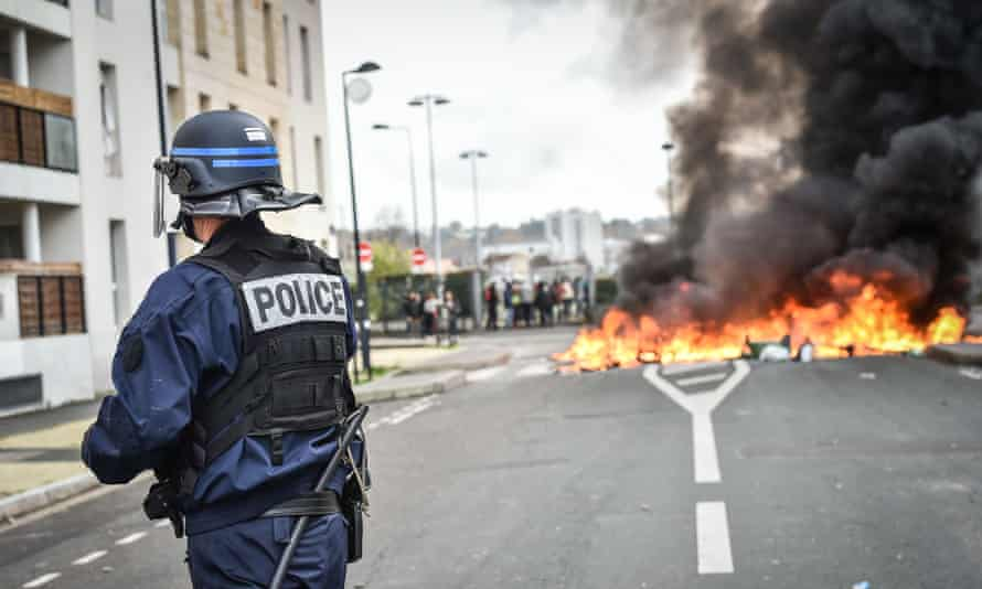 Students blockade the front of a Bordeaux high school during a protest against changes to education policy.