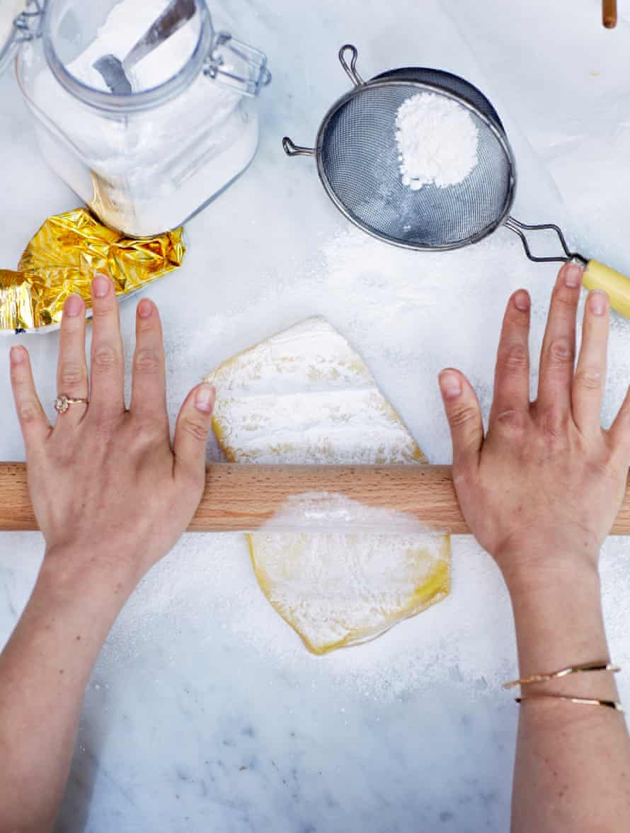 Lightly dust a work surface with the icing sugar. Roll the block of marzipan out and trim to 20cm x 30cm.