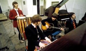 Ringo Starr, John Lennon, George Harrison and Paul McCartney in the studio.