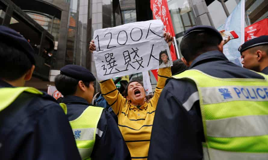 A protester holds a banner with the picture of Carrie Lam, who has been voted in as Hong Kong's next chief executive.