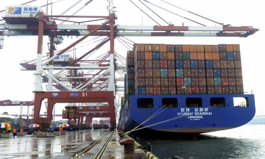 A container ship being loaded in Qingdao, Shandong province, China.