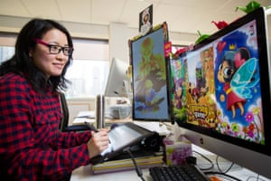 Digital artist and computer gamer Leonie Yue at her work desk in South Melbourne.