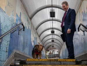 London, England Labour leader Keir Starmer meets Lucy the terrier after a surgery visit in Newham