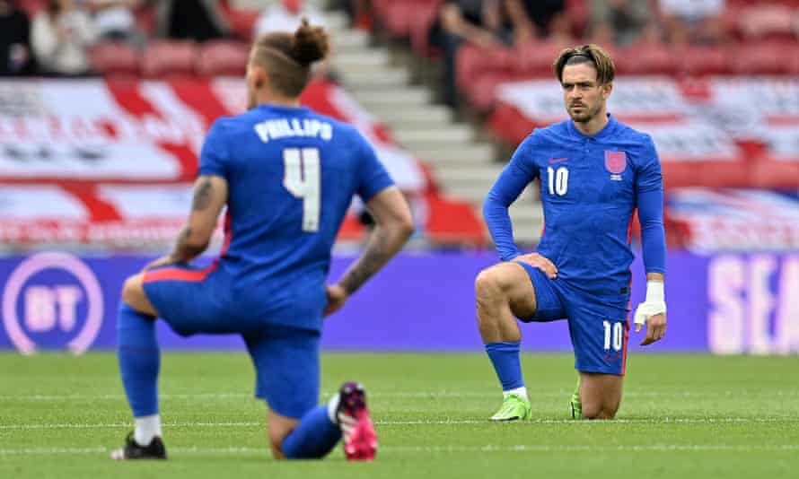 Kalvin Phillips and Jack Grealish take the knee before the friendly against Romania at the Riverside Stadium – a move which was booed by some fans.