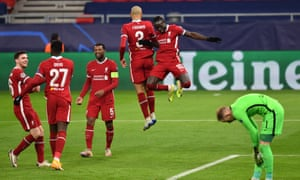 Sadio Mane jumps for joy after doubling the lead.