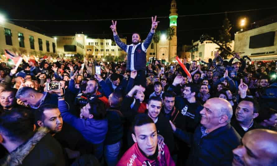 Palestinians celebrate Yaqoub Shaheen's victory in Bethlehem on Saturday night.