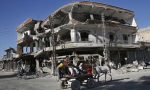 In this Thursday, April 5, 2018 photo, the remains of buildings line a street that was damaged last summer during fighting between U.S.-backed Syrian Democratic Forces fighters and Islamic State militants, in Raqqa, Syria. Six months after IS was driven out, residents of Raqqa feel they have been abandoned as the world moves on. They are trying to rebuild but fear everyone around them: the Kurdish-led militia that administers the majority Arab city; Syrian government forces nearby; gangs who kidnap or rob whoever shows signs of having money; and IS militants who may still be hiding among the people. (AP Photo/Hussein Malla)