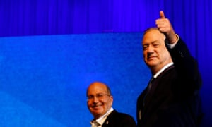 Blue and White party leader Benny Gantz gestures as he stands next to co-leader Moshe Yaalon after exit polls announced in Israel's election at the party's headquarters in Tel Aviv, Israel 3 March 2020.