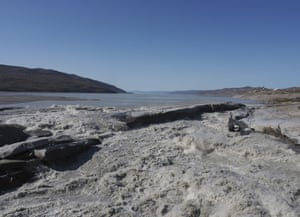 Meltwater flows into a fjord near Kangerlussuaq in western Greenland