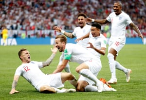 Kieran Trippier, left, is mobbed by his England team-mates after opening the scoring against Croatia.
