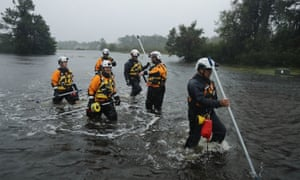 Members of the FEMA Urban Search and Rescue Task Force 4 from Oakland, California, search a flooded neighborhood for evacuees during Hurricane Florence in Fairfield Harbour, North Carolina.