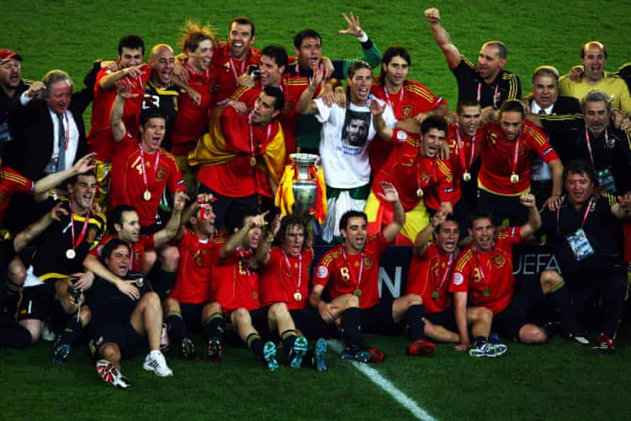 Spanish players pose for a team photograph with the trophy.